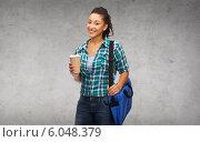 Купить «smiling student with bag and take away coffee cup», фото № 6048379, снято 19 января 2020 г. (c) Syda Productions / Фотобанк Лори