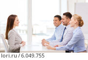 Купить «smiling businesswoman at interview in office», фото № 6049755, снято 5 апреля 2014 г. (c) Syda Productions / Фотобанк Лори
