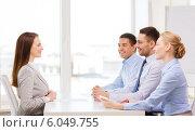 Купить «smiling businesswoman at interview in office», фото № 6049755, снято 5 апреля 2014 г. (c) Syda Productions / Фотобанк Лори