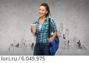 Купить «smiling student with bag and take away coffee cup», фото № 6049975, снято 15 сентября 2019 г. (c) Syda Productions / Фотобанк Лори