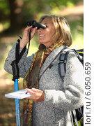 Купить «Woman in woods orienteering», фото № 6050659, снято 18 октября 2010 г. (c) Phovoir Images / Фотобанк Лори