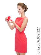 Купить «smiling young woman in red dress with gift box», фото № 6059327, снято 1 июня 2014 г. (c) Syda Productions / Фотобанк Лори