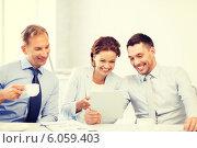 Купить «business team having fun with tablet pc in office», фото № 6059403, снято 9 июня 2013 г. (c) Syda Productions / Фотобанк Лори