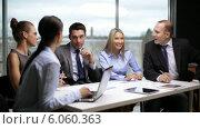 Купить «Business people having a meeting», видеоролик № 6060363, снято 12 ноября 2013 г. (c) Syda Productions / Фотобанк Лори