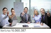 Купить «Business people having a meeting», видеоролик № 6060387, снято 3 декабря 2013 г. (c) Syda Productions / Фотобанк Лори