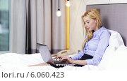 Купить «Businesswoman working with laptop computer in hotel», видеоролик № 6060423, снято 3 декабря 2013 г. (c) Syda Productions / Фотобанк Лори
