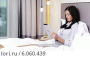 Купить «Businesswoman working with tablet pc computer in hotel», видеоролик № 6060439, снято 3 декабря 2013 г. (c) Syda Productions / Фотобанк Лори