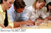 Купить «Casual business team taking notes in meeting», видеоролик № 6067307, снято 28 января 2020 г. (c) Wavebreak Media / Фотобанк Лори