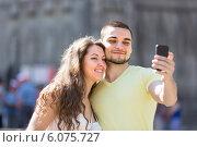 Купить «Couple doing selfie at the street», фото № 6075727, снято 11 июня 2014 г. (c) Яков Филимонов / Фотобанк Лори