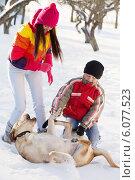 Купить «Girl and Boy in Snow Playing with Dog», фото № 6077523, снято 25 января 2014 г. (c) Майя Крученкова / Фотобанк Лори