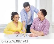 Купить «three smiling architects working in office», фото № 6087743, снято 17 мая 2014 г. (c) Syda Productions / Фотобанк Лори