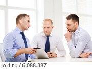 Купить «business team working with tablet pc in office», фото № 6088387, снято 10 мая 2014 г. (c) Syda Productions / Фотобанк Лори