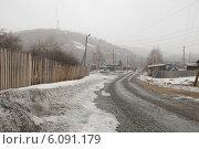 Купить «Деревенская улица зимой», фото № 6091179, снято 29 марта 2014 г. (c) Абышев А.А. / Фотобанк Лори