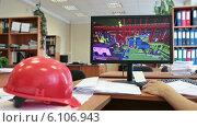 Купить «Рабочее место архитектора с экраном монитора и каской на столе», видеоролик № 6106943, снято 7 июля 2014 г. (c) Кекяляйнен Андрей / Фотобанк Лори