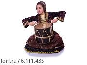 Купить «Young azeri woman playing traditional drum nagara», фото № 6111435, снято 28 февраля 2013 г. (c) Elnur / Фотобанк Лори