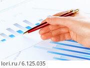 Купить «Analyzing report», фото № 6125035, снято 15 января 2014 г. (c) Sergey Nivens / Фотобанк Лори