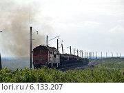Купить «Грузовой железнодорожный состав», фото № 6133207, снято 12 июля 2014 г. (c) Николай Новиков / Фотобанк Лори