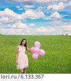Купить «young beautiful girl with baloons in the field», фото № 6133367, снято 16 мая 2014 г. (c) Майя Крученкова / Фотобанк Лори