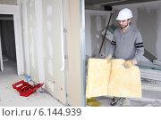 Купить «Tradesman installing insulation», фото № 6144939, снято 22 февраля 2010 г. (c) Phovoir Images / Фотобанк Лори