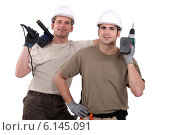 Купить «Manual workers with power tools», фото № 6145091, снято 17 января 2011 г. (c) Phovoir Images / Фотобанк Лори