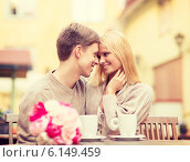 Купить «romantic happy couple kissing in the cafe», фото № 6149459, снято 6 сентября 2013 г. (c) Syda Productions / Фотобанк Лори