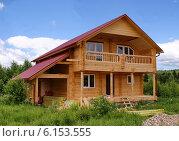 Купить «Строительство деревянного загородного дома из бруса», фото № 6153555, снято 12 июня 2014 г. (c) Павел Кричевцов / Фотобанк Лори