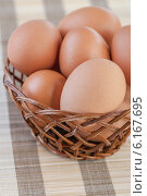 Купить «Wicker basket with chicken eggs», фото № 6167695, снято 28 октября 2011 г. (c) BestPhotoStudio / Фотобанк Лори