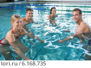 Купить «Fitness class doing aqua aerobics on exercise bikes», фото № 6168735, снято 10 апреля 2014 г. (c) Wavebreak Media / Фотобанк Лори