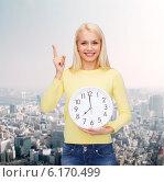 Купить «student with wall clock and finger up», фото № 6170499, снято 15 апреля 2014 г. (c) Syda Productions / Фотобанк Лори