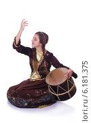 Купить «Young azeri woman playing traditional drum nagara», фото № 6181375, снято 28 февраля 2013 г. (c) Elnur / Фотобанк Лори