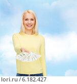 Купить «smiling girl with dollar cash money», фото № 6182427, снято 15 апреля 2014 г. (c) Syda Productions / Фотобанк Лори