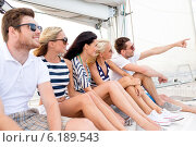 Купить «smiling friends sitting on yacht deck», фото № 6189543, снято 13 июля 2014 г. (c) Syda Productions / Фотобанк Лори