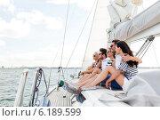 Купить «smiling friends sitting on yacht deck», фото № 6189599, снято 13 июля 2014 г. (c) Syda Productions / Фотобанк Лори