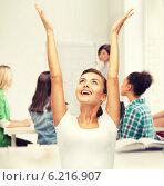 Купить «happy student girl with hands up», фото № 6216907, снято 1 июня 2013 г. (c) Syda Productions / Фотобанк Лори