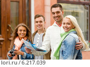 Купить «group of smiling friends with map and photocamera», фото № 6217039, снято 14 июня 2014 г. (c) Syda Productions / Фотобанк Лори