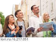 Купить «group of friends with city guide, map and camera», фото № 6217051, снято 14 июня 2014 г. (c) Syda Productions / Фотобанк Лори