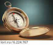 Купить «Compass on green background with space for text. Navigation.», фото № 6224767, снято 19 августа 2019 г. (c) Maksym Yemelyanov / Фотобанк Лори