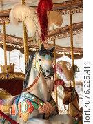 Купить «Фигура лошади на карусели», фото № 6225411, снято 10 июля 2014 г. (c) Елена Медведева / Фотобанк Лори