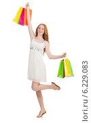 Купить «Woman after shopping spree on white», фото № 6229083, снято 25 июня 2014 г. (c) Elnur / Фотобанк Лори