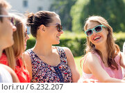 Купить «group of smiling friends outdoors sitting in park», фото № 6232207, снято 20 июля 2014 г. (c) Syda Productions / Фотобанк Лори