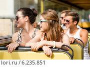 Купить «group of smiling friends traveling by tour bus», фото № 6235851, снято 20 июля 2014 г. (c) Syda Productions / Фотобанк Лори