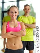 Купить «smiling man and woman in gym», фото № 6250283, снято 29 июня 2014 г. (c) Syda Productions / Фотобанк Лори