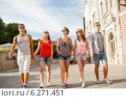 Купить «group of smiling friends walking in city», фото № 6271451, снято 20 июля 2014 г. (c) Syda Productions / Фотобанк Лори