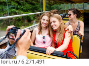 Купить «smiling friends with camera traveling by tour bus», фото № 6271491, снято 20 июля 2014 г. (c) Syda Productions / Фотобанк Лори