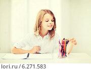 Купить «girl drawing with pencils at school», фото № 6271583, снято 31 июля 2013 г. (c) Syda Productions / Фотобанк Лори