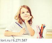 Купить «girl drawing with pencils at school», фото № 6271587, снято 31 июля 2013 г. (c) Syda Productions / Фотобанк Лори