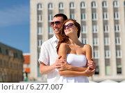Купить «smiling couple in city», фото № 6277007, снято 23 июля 2014 г. (c) Syda Productions / Фотобанк Лори
