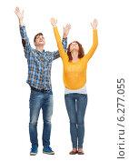 Купить «smiling teenagers with raised hands», фото № 6277055, снято 22 июня 2014 г. (c) Syda Productions / Фотобанк Лори