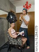 Купить «Woman drying hair and a man playing trumpet.», фото № 6284079, снято 23 марта 2019 г. (c) BE&W Photo / Фотобанк Лори