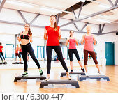 Купить «group of smiling female doing aerobics», фото № 6300447, снято 28 сентября 2013 г. (c) Syda Productions / Фотобанк Лори